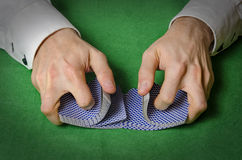 Hands shuffling cards in casino Stock Image