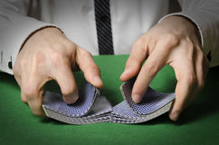Hands shuffling cards casino Stock Photo