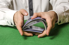 Hands shuffling cards casino Stock Photos