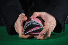 Hands shuffling cards casino Stock Images