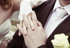 Hands with silver wedding rings Stock Images