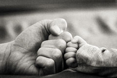 Hands. Single and lonely hand child Infant b&w Stock Photo