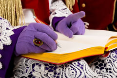 Hands of sinterklaas with book. Detail Sinterklaas  with empty book. isolated on white background. Dutch character of Santa Claus Royalty Free Stock Image