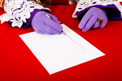 Hands of sinterklaas with empty check list Royalty Free Stock Image