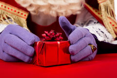 Hands of Sinterklaas with present Royalty Free Stock Image