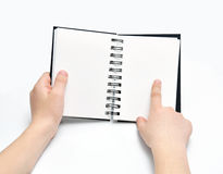 Hands with sketch book. Two hands holding book note, empty pages, finger aiming Stock Photos