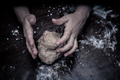 Hands skillfully knead the dough Royalty Free Stock Photography