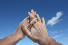 Hands and sky Stock Photos