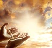 Hands in sky Stock Images