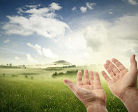 Hands in sky Stock Images