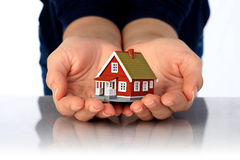 Hands and small house. Royalty Free Stock Photo