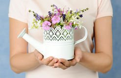 Hands with small summer bouquet Stock Photo