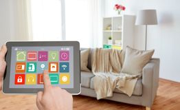 Hands with smart home icons on tablet computer royalty free stock photography