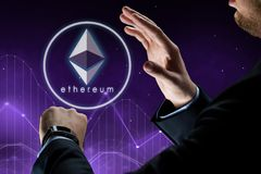 Hands with smart watch and ethereum hologram. Business, cryptocurrency and future technology concept - close up of businessman hands with smart watch and Royalty Free Stock Image