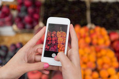 Hands with smartphone taking picture of fruits Royalty Free Stock Photos