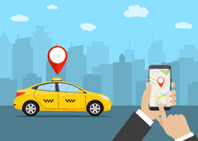 Hands with smartphone and taxi application. Taxi service. Yellow taxi cab. Hands with smartphone and taxi application, city silhouette with skyscrapers and tower Royalty Free Stock Image