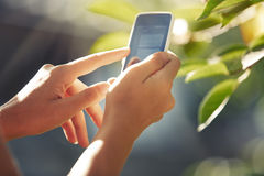 Hands with smartphone Royalty Free Stock Photo