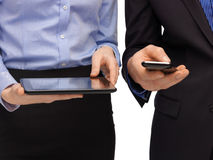 Hands with smartphones and tablet pc Stock Photography