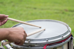 Hands smash on a snare drum Stock Images