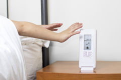 Hands snooze alarm clock in the morning Royalty Free Stock Photo