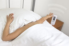 Hands snooze alarm clock in the morning Royalty Free Stock Photos