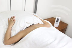 Hands snooze alarm clock in the morning Stock Photo