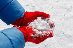 Hands with snow Stock Photos