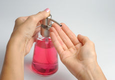 Hands And Soap Dispenser Stock Photo