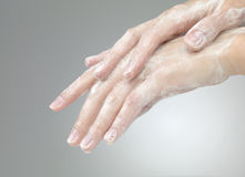 Hands with soap foam ad bubbles Stock Image