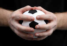 Hands with soccer ball Royalty Free Stock Images