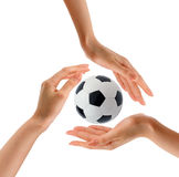 Hands and soccer ball. Save and hold it Royalty Free Stock Photography