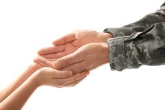 Hands of soldier and child. On white background Stock Image