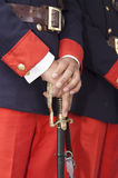 Hands of soldier with a sword Stock Photo