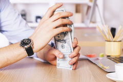 Hands sorting out dollars Royalty Free Stock Photography