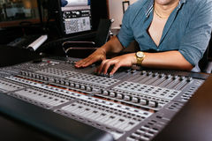 Hands of sound engineer. On the mixer console Royalty Free Stock Image