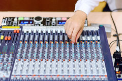 Hands at a sound mixing console Stock Images