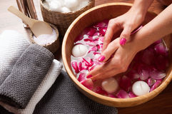 Hands spa, beautiful woman's hands in bowl of water Stock Photography