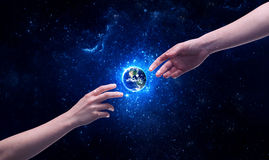 Hands in space touching planet earth Royalty Free Stock Images