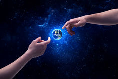 Hands in space touching planet earth Stock Image