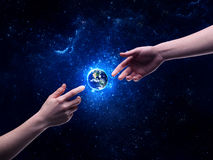 Hands in space touching planet earth Royalty Free Stock Photography