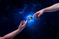 Hands in space touching planet earth Stock Photos