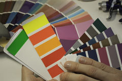 Hands, spectrum of colors. Selection of automobile enamels, spectrum Stock Images
