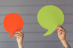 Hands with speech bubbles royalty free stock image