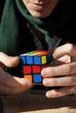 Hands speedcubing a Rubik's cube Royalty Free Stock Photo