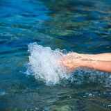 Hands splashing pure sea water Royalty Free Stock Image