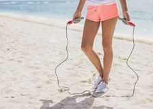 Hands of sporty woman holding skipping rope. Close up portrait of hands of sporty woman holding skipping rope at the beach Royalty Free Stock Photo
