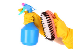 Hands with spray and cleaning brush Stock Images