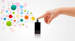 Hands spraying colorful bubbles Stock Photography