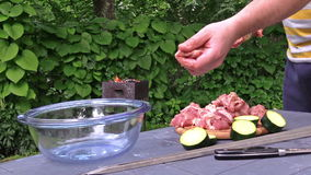 Hands stab meat and vegetable pieces on skewer. Fire in barbecue stock video