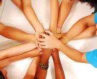 Hands stack together